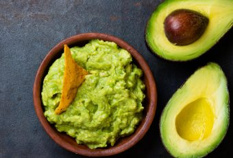 Latin American Sauce Guacamole And Avocado Sandwiches On Dark Background.